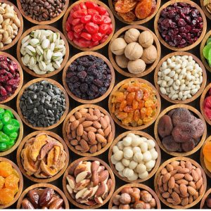 assorted-nuts-and-dried-fruit-background-organic-food-in-wooden-bowls-picture-id1154896831